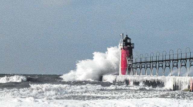 Wintry weather hits the South Haven Lighthouse at South Haven, Michigan.