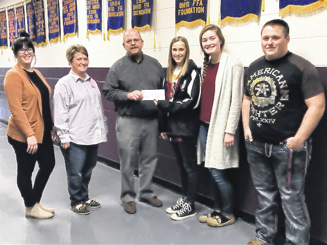 The Mechanicsburg FFA dedicated the month of October to raising funds for the Cancer Association of Champaign County. For the entire month the chapter sold meat sticks and gave the profits to the CACC. On Oct. 18, the chapter held a Potato Bar for all Mechanicsburg staff for a donation to the CACC. In total $500 was raised for the CACC. All money collected by the CACC stays in Champaign County to be available for cancer patients. CACC provides medication, treatment assistance, gas cards and prosthesis. To reach the CACC, call 937-653-3899. In the photo representing the CACC are, from left, Whitney Denson, patient services, Stacey Neer, treasurer, and President Brett Evilsizor. Handing the check to Evilsizor is Mechanicsburg FFA President Taylor Ayars along with Vice President Elly Schipfer and Sentinel Levi Adams.