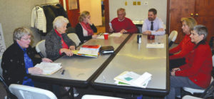New board members seated at Mburg library