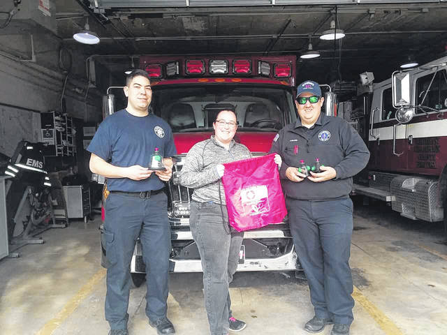 From left are Josh Furlong, NCCFD firefighter/medic; Nicole Schoening of Invisible Fence; and Nick Kamaka, NCCFD firefighter/EMT.