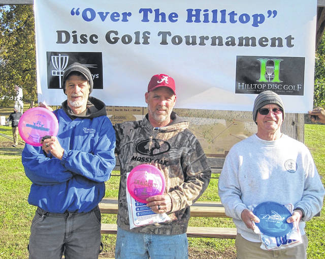 """The first annual """"Over The Hilltop"""" Disc Golf Tournament was played at the Hilltop Disc Golf Course, Melvin Miller Park, Urbana, on Saturday, Nov. 3. The event was sponsored by the Hilltop Disc Golf Club with proceeds going to course improvement. First-place winners in their divisions (pictured from left) were J.P. Perry (Super Senior: 60-69), Andy Sherman (Senior: 50-59), and Terry Evans (Just Plain Old: 70+)."""