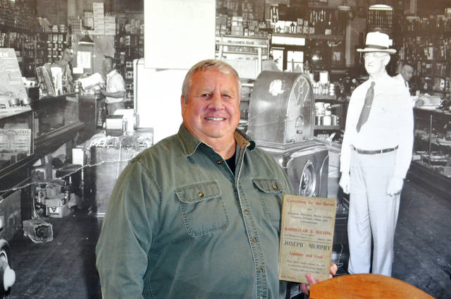Mike Manoloff, owner of Oxner's General Store on Monument Square, recently discovered an Urbana phone book from 1909/1910. The advertisement on the front is for H. Holding & Company, which occupied the Oxner's location over 100 years ago. The man pictured prominently at the front of the photo behind the Oxner's cash register is Ed Holding, the original owner of H. Holding & Company. Manoloff is seeking the identify of the three customers pictured in the background of the photo. If able to help, please call (937) 653-6963.