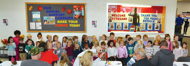 "Thirty-four pre-schoolers at the Champaign Family YMCA sang ""Hello Mr. Turkey"" and ""I'm Glad I'm Not A Turkey"" for parents at the Pre-School Family Feast on Thursday."