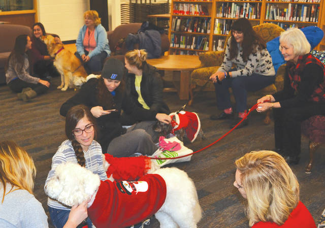 Five dogs and their owners from the Alliance of Therapy Dogs visited Urbana University students in the library on Tuesday to help give them some stress relief during finals week.