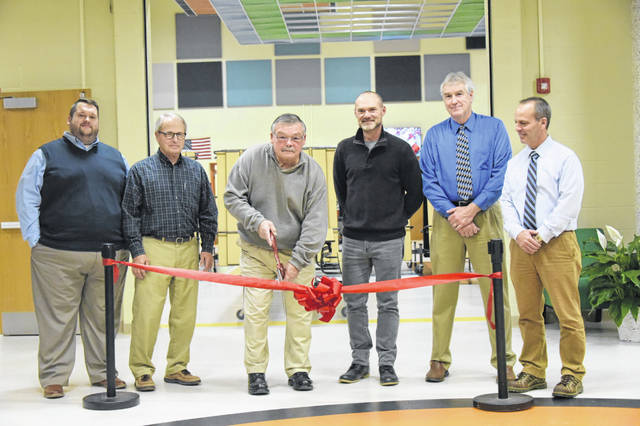 From left, WL-S board members Tim Lamb, Steve Lapp, Chuck Buck, Pat Adams, Dave Cline and Chris Moell cut the ribbon in the main entrance to the new and renovated preK-12 building.