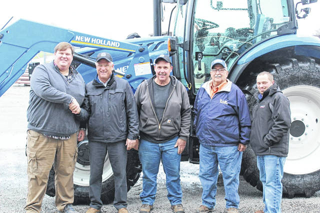 From left are Matt Apple, Mechanicsburg store manager; Dean Blair, executive director; Dave Hosier, maintenance supervisor; Bill Agle, president of the Clark County Ag Society; and Zach Dennis, Apple Farm Service sales specialist.