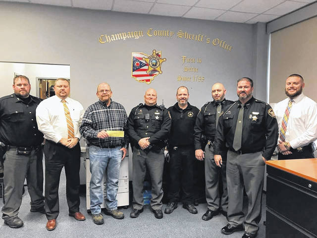 "Sheriff Matthew R. Melvin, Judge Brett Gilbert and Deputies of the Champaign County Sheriff's Office, in conjunction with the Champaign County Deputies Association, were proud to have participated in ""No Shave November."" A check for $1,000 was presented to the Cancer Association of Champaign County as a result of the fundraiser."