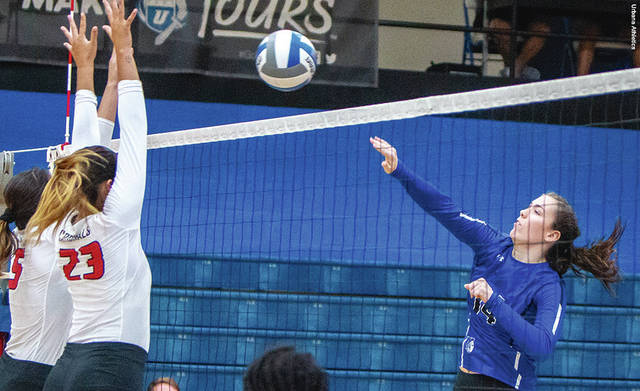 Urbana University's Madison Davis (right) has been named first-team All-MEC in volleyball.