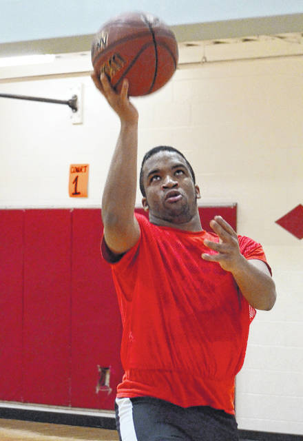 Corey Ford drives for a layup during a competitive layup line at the YMCA on Tuesday, Dec. 18.