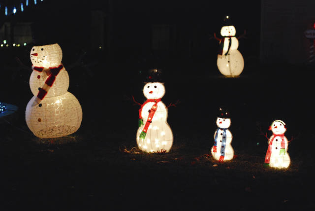 This family of illuminated snow creatures is part of the holiday decorations on Fountain Circle in Urbana. Although it wasn't a white Christmas this year, the morning after Christmas was blanketed in frozen fog. There is no snow in the forecast for the rest of 2018.