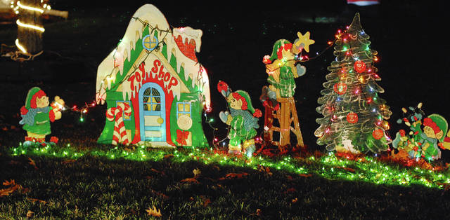 The neighbors of Fountain Circle in Urbana have decked out their little community for Christmas once again this year. The neighborhood is located at the east end of Boyce Street. In photo is one of the larger and intricate yard displays motorists can enjoy while driving through the neighborhood.