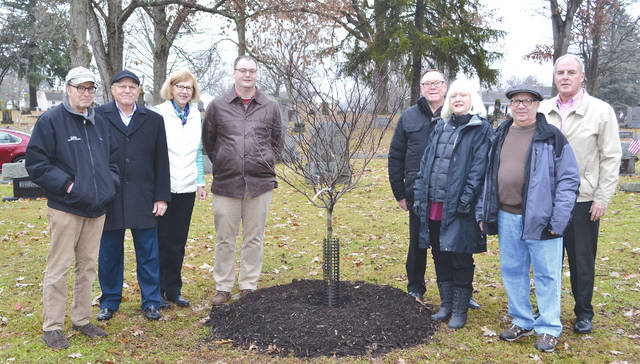 Relatives of Karen Kerns Dresser donated $50,000 to Urbana's tree planting fund at Oak Dale Cemetery. Ten trees were planted this week. From left are Barry Reich, Mike Birck, Sharon Kerns, Urbana Community Development Manager Doug Crabill, Mayor Bill Bean, Lynn Reich, Marty Reich and city administrator Kerry Brugger. They are standing by a newly-planted Pagoda Dogwood trees on Friday.