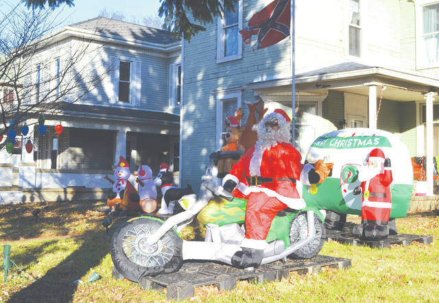 Santa evidently rolled into Urbana on a motor bike and parked at 815 N. Main St., one of the city's many homes with ample holiday spirit. Decorations here include a tree with lights and several snowmen.