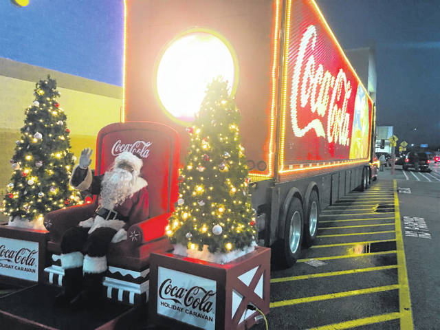"Santa made an unexpected surprise visit via semi-truck to the London, Ohio, Walmart over the weekend. The truck travels the United States during the holiday season and London, which is near Interstate 70, was treated to a rare visit. For more than 20 years these ""Santa Semis"" have traveled around America and the world spreading holiday cheer. Each truck has over 30,000 lit bulbs."