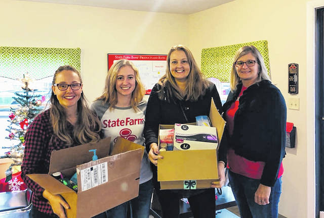 Erin Patton State Farm, Urbana, collected and donated items to Project Woman along with $250. State Farm matched the donation with another $250 for Giving Tuesday. From left are Erin Patton, Morgan Edwards of State Farm, Audrey Ferryman of Project Woman and Holly Powell of State Farm.