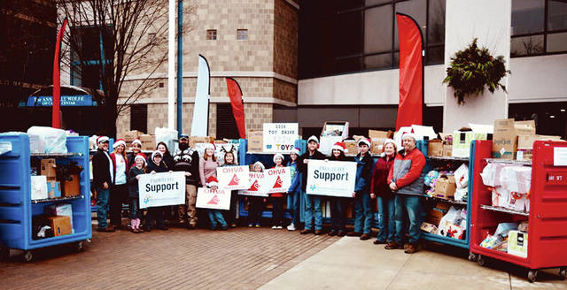 Tyler and Monica Slaven's Toy Drive group is pictured in front of Nationwide Children's Hospital of Columbus, where the group dropped off the 9,224 toys collected over the past two months.