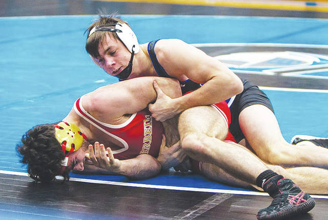 Urbana University's Cole Hauser wrestles Otterbein's Joey Bradberry at 157 pounds. Houser won match.