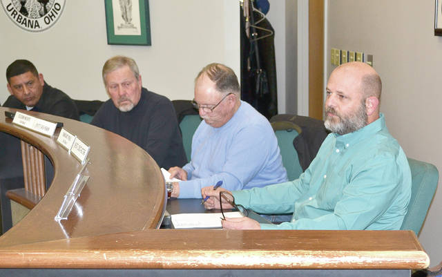 Urbana council member Dwight Paul, right, who is sponsoring the proposed income tax increase, addresses one of the citizens attending the public hearing on Tuesday. From left are council members Tony Pena, Pat Thackery and Cledis Scott.