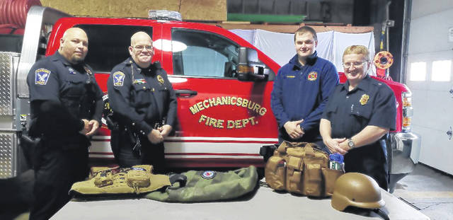 Pictured with grant-funded equipment are four Mechanicsburg first responders who participated in the training. From left are Police Officer Chad Taylor, Police Chief John Alexander, Fire Lt. Matthew Bebout and Asst. Fire Chief Steve Castle.