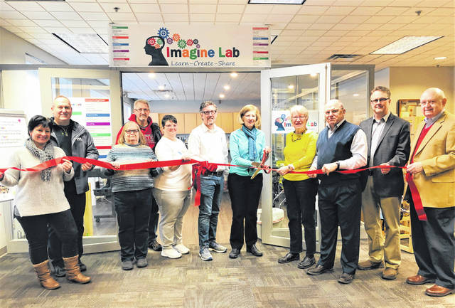 The Champaign County Chamber hosted a ribbon-cutting at the new Imagine Lab at the Champaign County Library in Urbana. From left are Susie Koennecke, Kirk Koennecke, Kay Schenkel, Jim Zaborowski, Gloria Malone, Ty Henderson, Champaign County Library director, Sharon Kerns, Jennifer Kerns Ivory, Mike Birck, Scott Fannin and Mike Melvin.
