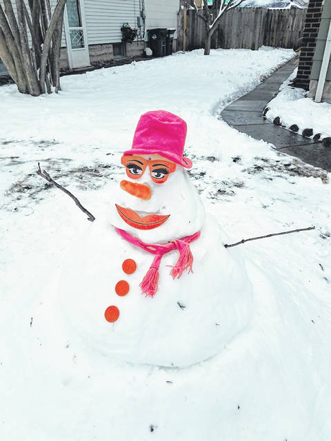 This snow girl was built on Lincoln Place in Urbana after last weekend's snow. More snow is in the forecast this weekend.