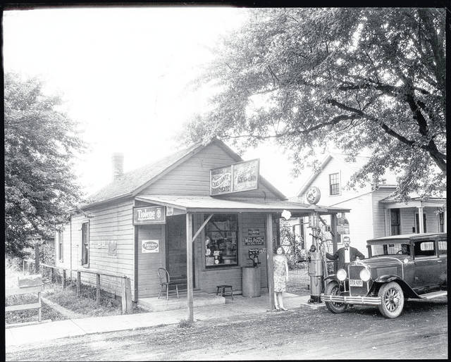 This is a circa 1929 photo (CCHS #0206) of the Charles Lantz Grocery and Gas Station at 405 Gwynne St., Urbana. This was a family business involving Mr. Lantz, his wife (visible in the window) and daughter. Signs indicate the following merchandise was available: Tiolene motor oil, Taystee Bread, Purity Ice Cream, Mail Pouch tobacco, Beech-nut tobacco, Fels Naptha, Old Reliable coffee. This would have been a challenging time to operate a business. <em>The Champaign County Historical Society is an all-volunteer, not-for profit organization that preserves, protects, archives and displays the artifacts that tell the Champaign County story. The society depends upon donations and dues to provide a free public museum, which is open 10 a.m.-4 p.m. Mondays and Tuesdays.</em>