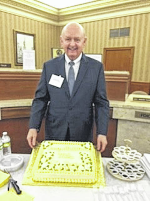 Michael Melvin, president of Perpetual Federal Savings Bank, was honored for his 50 years of service during the annual stockholders meeting.
