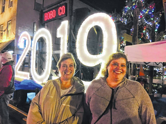 Pam McIntosh and Kari McCabe celebrate new year in New York-style New Year's Eve ball drop in New Carlisle.