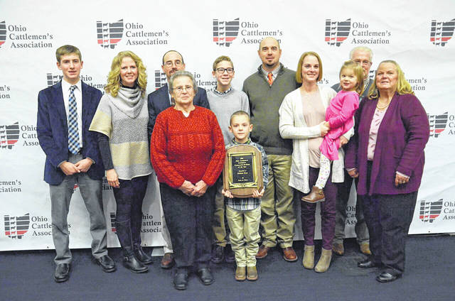 The Robison family was honored with the Commercial Producer of the Year Award at the Ohio Cattlemen's Assn. Banquet on Jan. 12. Pictured are, back from left, Zane, Amanda, Thad, Wyatt and Allan Robison, Mark Zeller, front from left, Connie, Noah, Kelley and Josie (in arms) Robison and Barb Zeller.