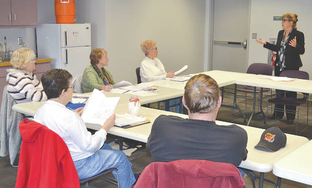 Urbana Champaign County Senior Center Executive Director Stacy Barnhart spoke to Public Employee Retirees Inc. (PERI) members about plans for a new senior center during a meeting at the Champaign County Library on Tuesday.