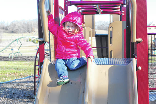 Richaela Wolf, age 2 of Mechanicsburg, enjoys the sunshine and playground at Melvin Miller Park on a recent balmy afternoon. Temperatures in Champaign County have been above average for January. Winter temperatures are expected to return Wednesday after a mild opening to 2019.
