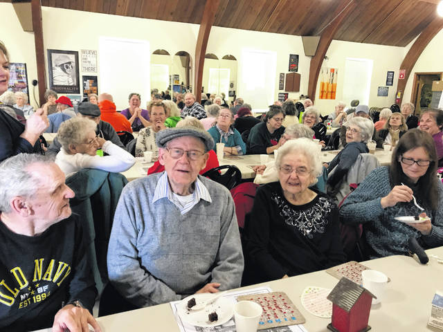 Robert and Dorothy Chamberlain of Urbana, pictured in the center of photo, were surprised to find 85 friends awaiting them Tuesday at the Urbana Champaign County Senior Center. The gathering threw the couple a 70th wedding anniversary party. The Chamberlains have participated in Senior Center activities for many years.