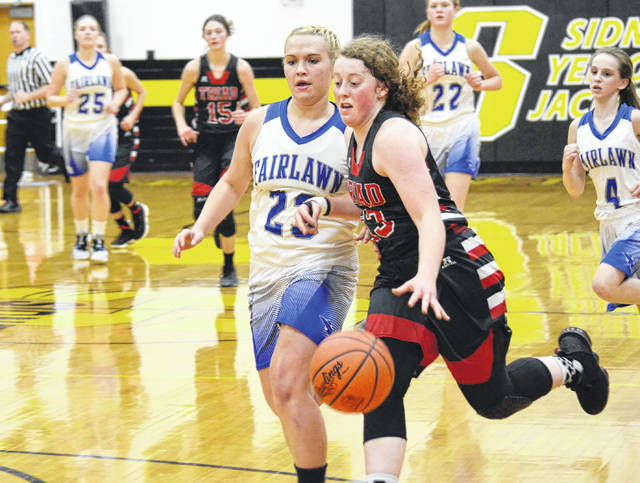 Triad's Cati LeVan (13) leads the break against Fairlawn on Tuesday. LeVan scored 21 points to keep Triad in the game.