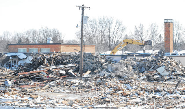 Demolition crews reduce Urbana East Elementary to rubble this week at the corner of Washington and Jefferson.