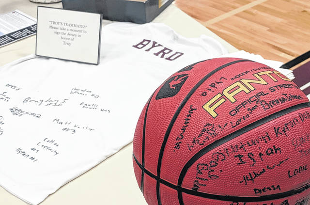 Honoring Troy's love of basketball, well-wishers entering the gymnasium signed a ball and his teammates signed a jersey to commemorate his life.