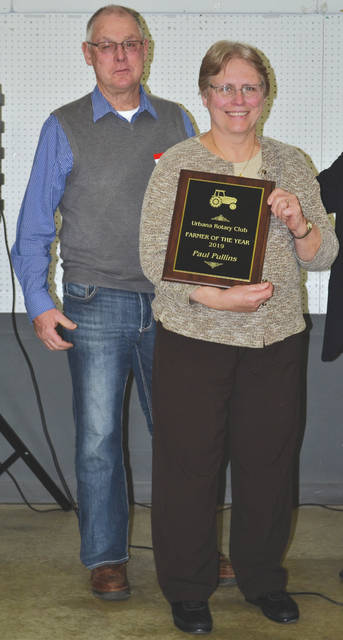 Paul Pullins, shown with his wife, Cathy, was named the 2019 Farmer of the Year at the Urbana Rotary Club's Rural Urban Night on Monday at the Champaign County Fairgrounds.