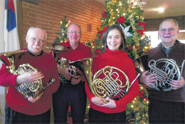 The Valley Horns performed French Horn Quartets at the Christmas meeting. From from left are Colvin Bear, Steve Vrooman, Krista Caley and Brian Stiffler.