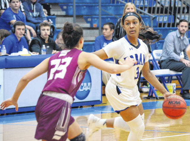 Urbana University's Sa'Dera Johnson (3) probes the defense for an opening against Fairmont State on Thursday.