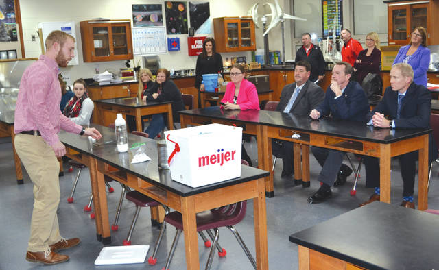 Triad board of education members and administrators watch science instructor Aaron Clune demonstrate an experiment with dry ice during Thursday's regular board meeting. He said that about 40 students had been regularly attending his after-school Science Club.
