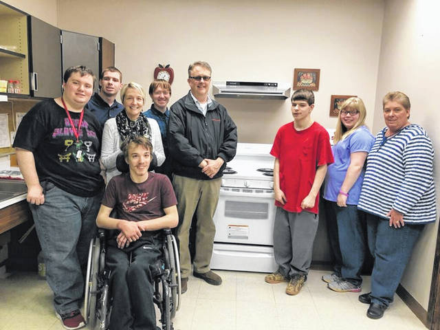When Kim Rowland, graduate regent of Women of the Moose, learned about the need for a new stove in the Life Transition Class of the Champaign-Madison Educational Service Center, the WOTM raised funds and teamed with Scott Fannin of Willman Furniture and class teacher Cheryl Leffel to get the stove delivered. Pictured are teacher Cheryl Leffel, students Josh, Andrew, Kobie, Nick, Wesley and Hannah, Fannin and Rowland.