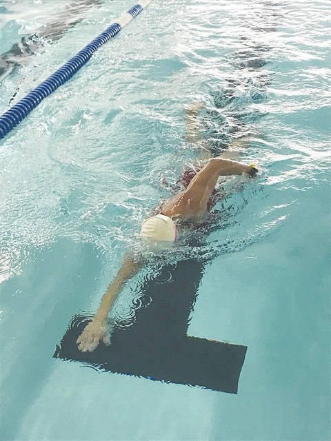 Swimming is part of the action during Sunday's Triathlon at the Champaign Family YMCA.