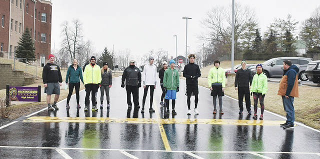 "Freeze Out participants included, from left, Johnny Schipfer, Kim Drexler, Briley Ritchason, Tony Blakeman, Amanda Carmichael, Jon Umstead, Gaven Haffner, Carol Umstead, Garrett ""Goose"" Durham, Josh Spinner, Mason Ritchason, Jonathon Pack, Kathy Durham and starter Stan Oliver."