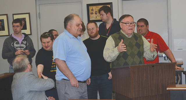 Urbana Mayor Bill Bean is joined by clients of the Champaign County Board of Developmental Disabilities as he reads a proclamation supporting the month of March as Developmental Disabilities Awareness Month.