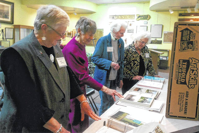 "Lana Seeberg, Margaret Denzer, Dolores Botkin and Judith Henson were among those attending the CCCRP LLC ""Year in Review Gathering,"" and viewing the work done by the local volunteers. All guests appreciated the power point presentation, prepared by James Landenburg, of the Champaign County Engineer's office."