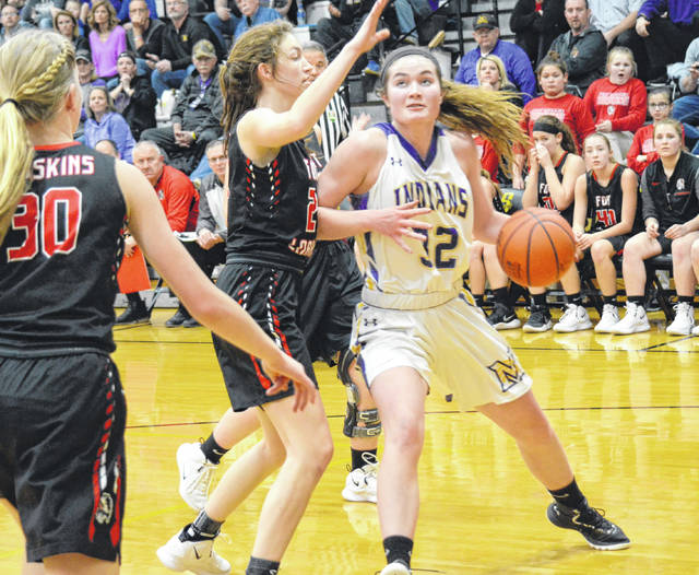 Mechanicsburg senior Elly Schipfer (32) backs her defender down on Wednesday against Fort Loramie. The Indians came up short against the state's top-ranked team in Schipfer's final appearance as an Indian.