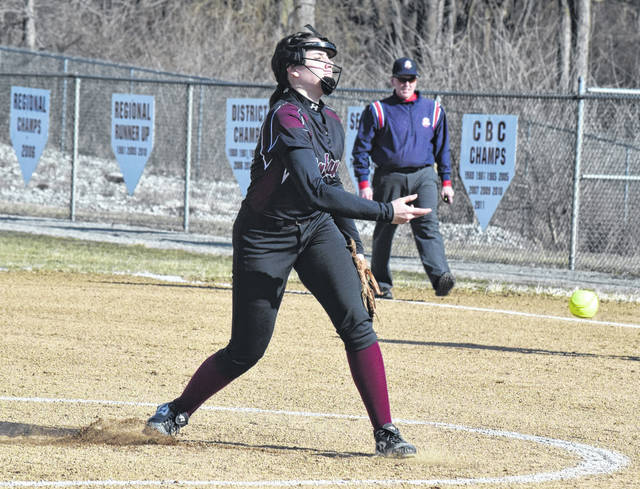 Urbana's Emily Skelley fires a pitch to home during the first inning of Wednesday's contest with Springfield. Skelley pitched three innings, striking out eight batters.