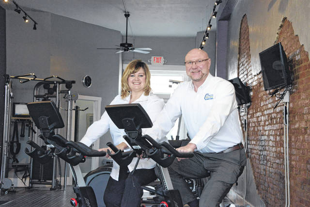 """Cynthia and Greg Dove of Mechanicsburg, shown here, have opened a Fitness Machine Technicians business in the Columbus area. With several sites in the United States, Fitness Machine Technicians maintains and repairs exercise equipment for fitness centers, universities, hotels, etc. """"Having belonged to gyms my entire life, I have oftentimes seen equipment stand in disrepair for far too long,"""" said Mr. Dove. """"It's not enjoyable to wait in line for an elliptical, especially in a place you go to be active."""" For more information, visit www.FitnessMachineTechnicians.com/MidOhio."""