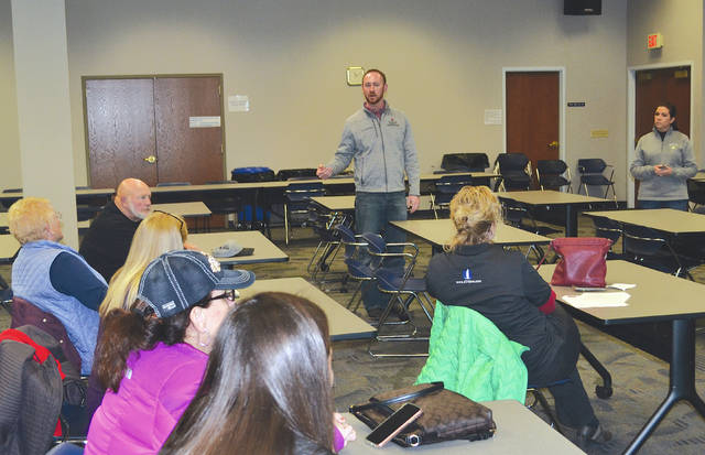 Nick and Mallory Zachrich, the owners of the Zachrich Hop Yard, present slides before a small group as part of the Champaign County Agricultural Association's winter speaker series on Thursday.