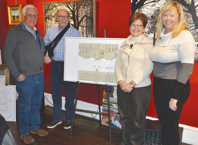 From left are investment committee co-chairs Mike Major and Terry Howell, Champaign Economic Partnership Executive Director Marcia Bailey and Kim Slesinger-Fraley standing by plans for Urbana's Cobblestone Hotel.