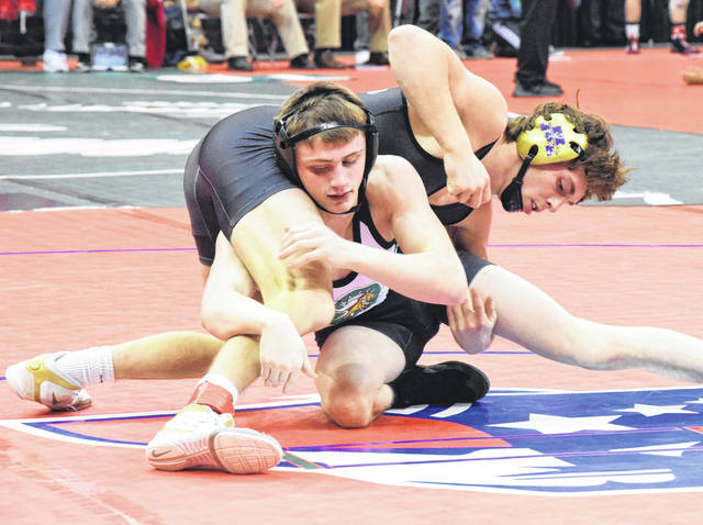 Mechanicsburg's Jake Hurst fights for control with Northridge's Klay Reeves at 132 pounds on Thursday. Hurst had control of the match early, but got nipped by a third-period takedown.